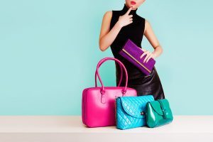 Woman thinking with many colorful bags. Shopping. Fashion image.