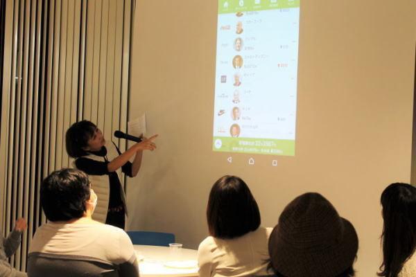 スマートフォンで米国株に1万円から投資できる「One Tap BUY」のサービス紹介も。(写真=筆者撮影)