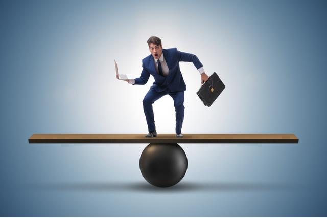 https://www.shutterstock.com/image-photo/businessman-trying-balance-on-ball-seesaw-789433873